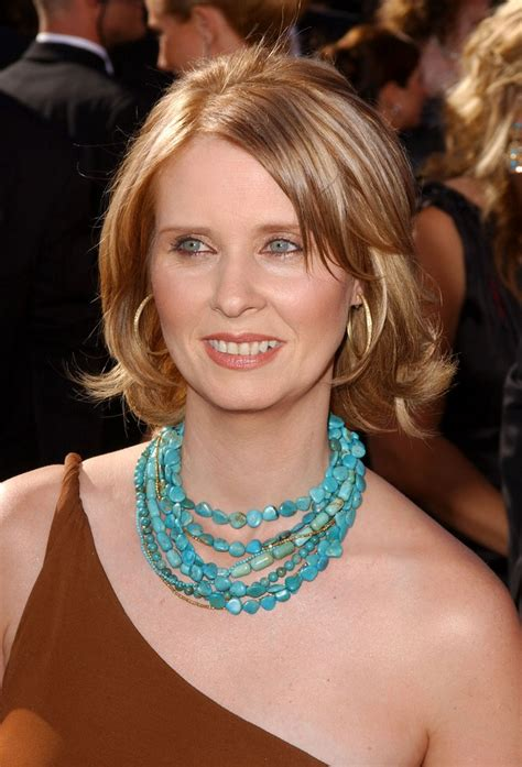 cynthia nixon sporting  midlength hairstyle  flipping