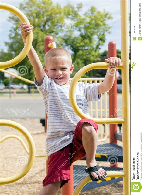 boy climbing up jungle on playscape royalty free stock 270 | boy climbing up jungle gym playscape young climbs yellow preschool playground 31332929