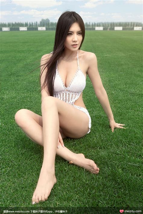 Long Legs Japanese Girl With Amazing Figure Photographed On The Short Grass Picture