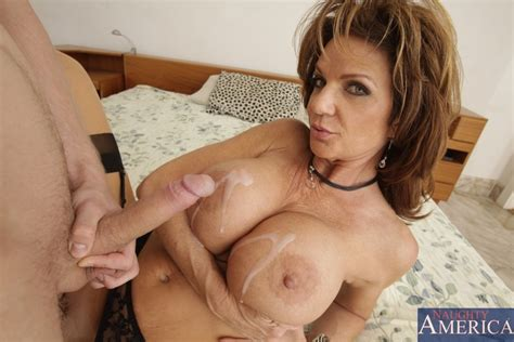 Busty Milf Deauxma Knows How To Use Her Large Hooters To Make Him Horny