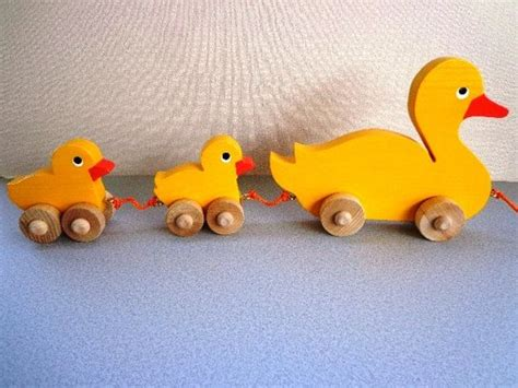 wooden mama duck  babies pull toy yellow