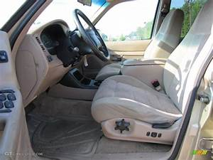 Medium prairie tan interior 1999 ford explorer xlt photo for 1999 ford explorer interior parts