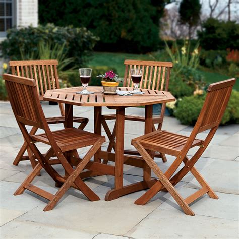 outdoor furniture table and chairs the trestle patio table and stow away chairs hammacher