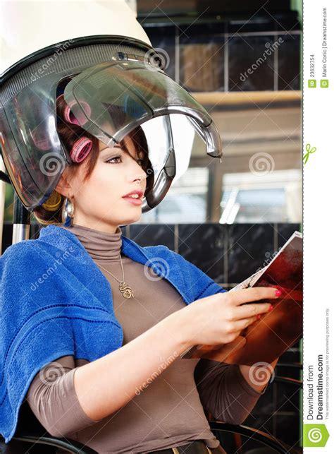 pretty woman  bonnet hair dryer stock photo image