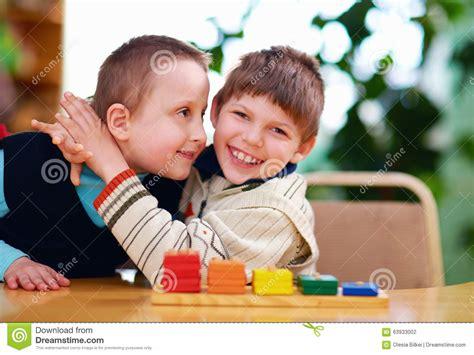 happy with disabilities in preschool stock photo 221 | happy kids disabilities preschool classroom 63933002