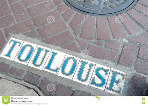 new orleans sign toulouse quarter stock