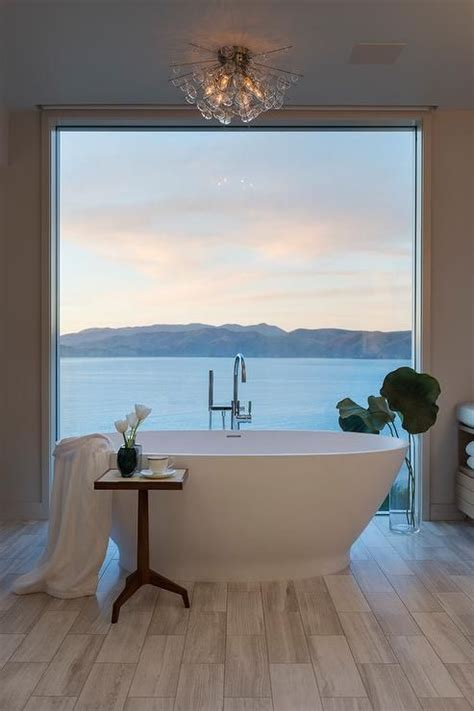 water front home boasts  restful bathroom featuring