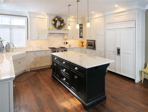 white kitchen  black island traditional kitchen