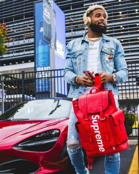 odell beckham jr outfit louis vuitton  supreme backpack