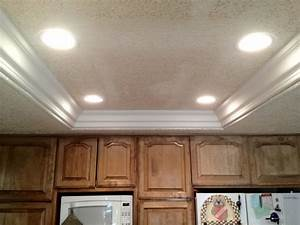 Remove fluorescent lights replace with can and