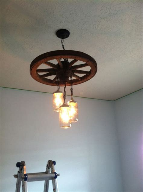 wagon wheel light with mason jars pin by michelle whiteley on shells pinterest