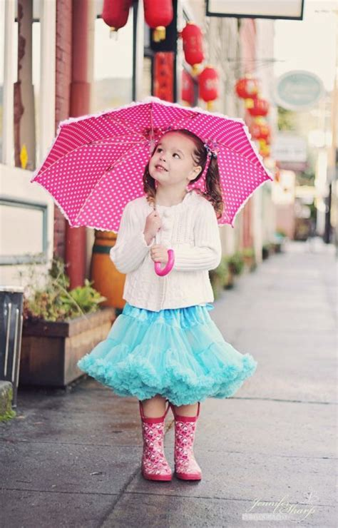 Picture Of pink printed rain boots, a ruffled blue skirt ...
