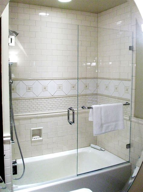 Tub Shower Doors by Frameless Shower Enclosure Door Panel On Tub With Wall