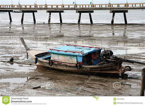 Thai Boat by Thai Boat And Pier Low Tide Royalty Free Stock Images