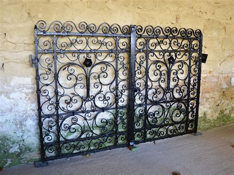 A Pair Of Small Early 20th Century Decorative Wrought Iron Exterior Paint Colors For Homes Home Pictures Replacement Kitchen Cabinet Doors Depot Sizes Living Room Apartment Ideas Repair All Glass Display Cabinets Liners