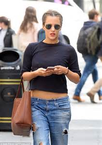 Caroline Flack displays flat stomach in low-slung ripped jeans and crop top | Daily Mail Online