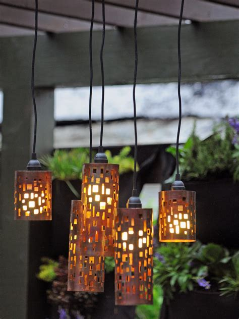 copper lanterns for candles set the mood with outdoor lighting hgtv
