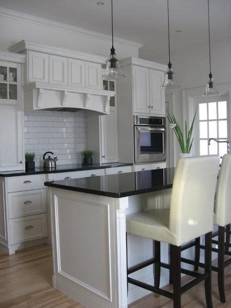 creamy white kitchen cabinets subway tiles backsplash