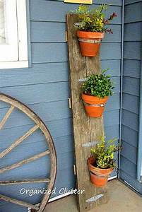 25 diy reclaimed wood projects for your homes outdoor With kitchen cabinets lowes with flower pot candle holder