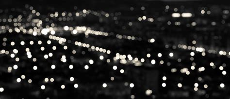 and white lights abstract white black circular bokeh background city