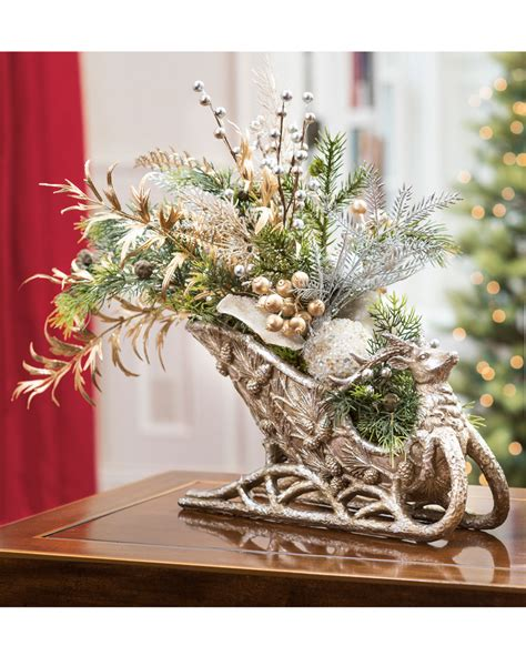 elegant holiday sleigh centerpiece at petals