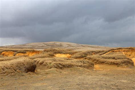 sand dunes   cloudy skies  hawaii image