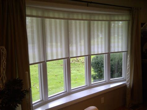 Close Fitting Shades In This Bow Window With Draperies