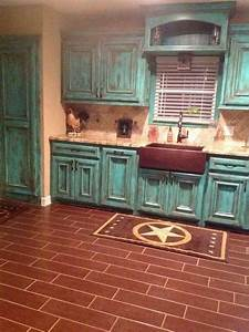 distressed turquoise cabinets cottage decor pinterest With kitchen colors with white cabinets with cowboy metal wall art