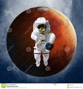 Astronaut, Holding A Planet Earth In Hand On Stock ...