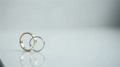 wedding rings on white background stock video