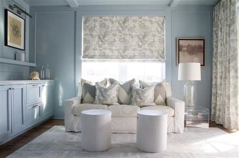 heather gray tufted sofa  clear acrylic coffee table