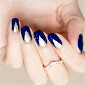 Nail art design themes with navy blue nails polish background