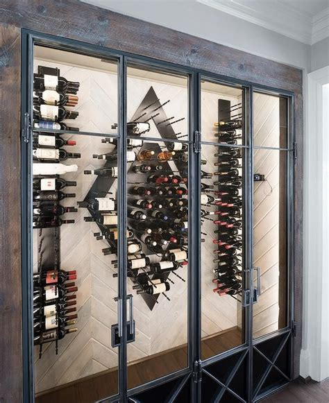 contemporary wine room features  wood herringbone wall fitted  modern vertical wine racks