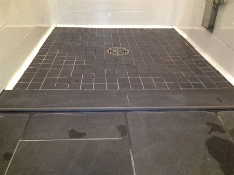 shower curb installation  nyc commercial restroom