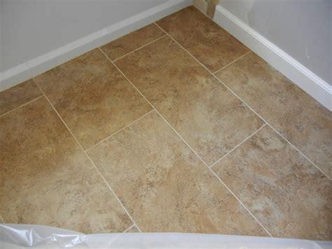 laying porcelain tile linoleum how to install ceramic floor tile linoleum gurus floor