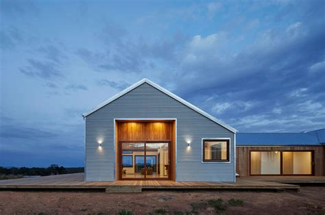 hillside cabin plans trentham modern farmhouse uses local materials to fit into