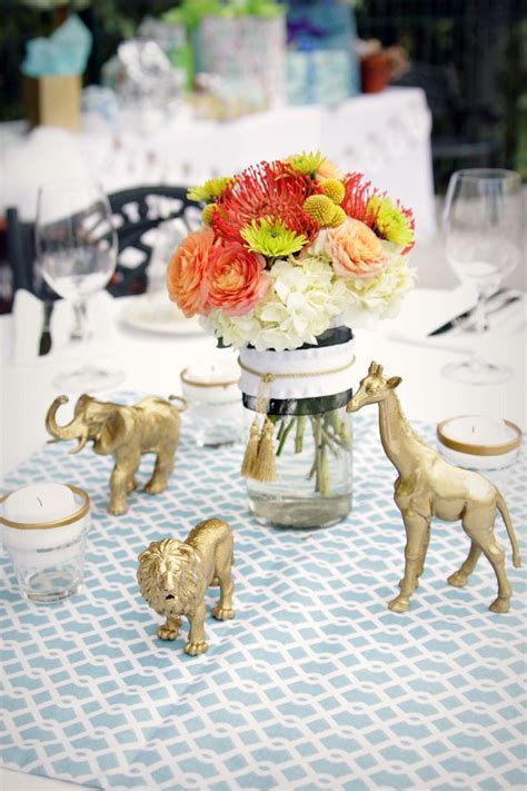 posh gold safari baby shower   baby shower decor