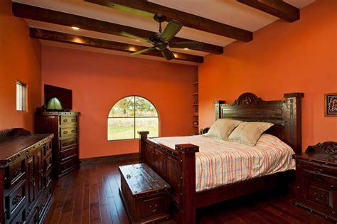 master bedroom orange colored walls exposed beams hardwood