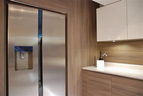white high gloss kitchen grey acacia panelling  brighton