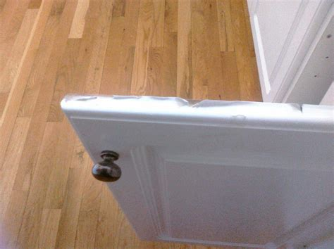 Peeling White Thermafoil Cabinet Door and Drawer Front