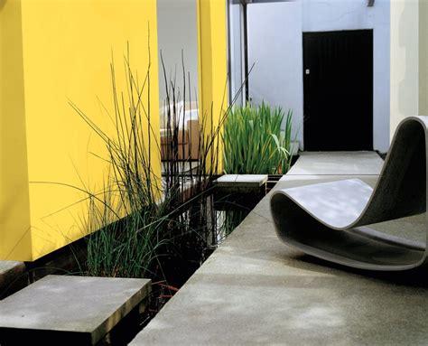 garden feature wall colours sandtex feature wall in lemon zest exteriors pinterest walls driveways and fences