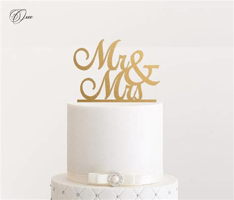 mr and mrs wedding cake topper by oxee metallic gold and