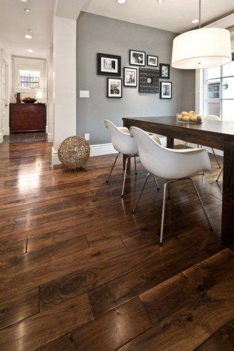 floors and light grey walls with neutral furniture