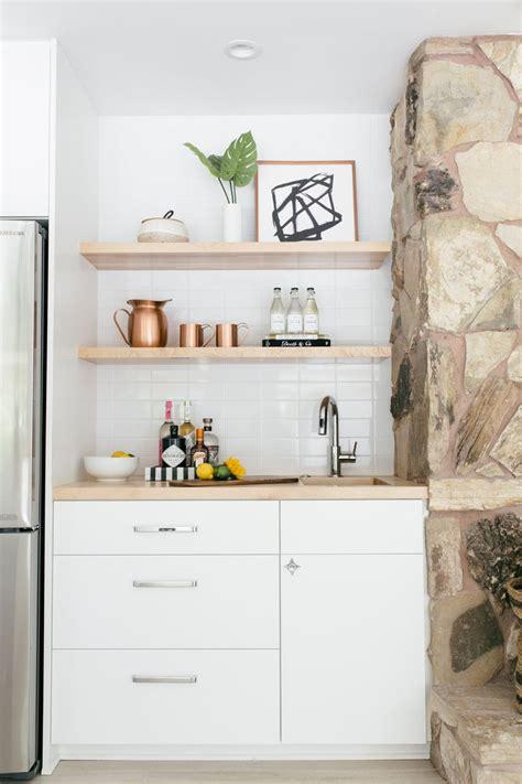 mid century styled wet bar  white cabinets  wood