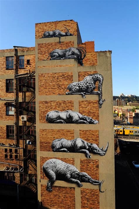 roa stacks african animals   building facade