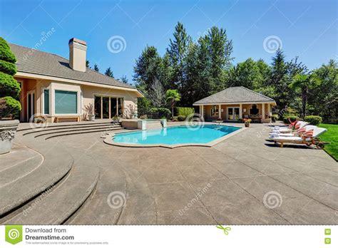 great backyard with swimming pool in american suburban