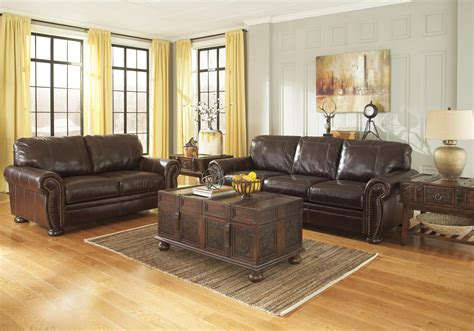 traditional leather match sofa  rolled arms nailhead