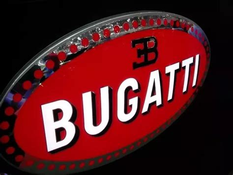 Macaron is the term bugatti uses for its distinctive enamelled oval badge, dating to the art nouveau heyday. What is the Bugatti logo? - Quora