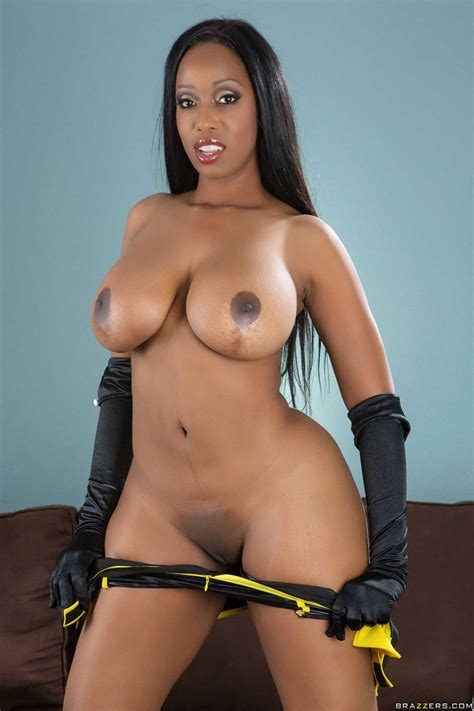 America Moore in latex boots and gloves posing on the couch - My Pornstar Book