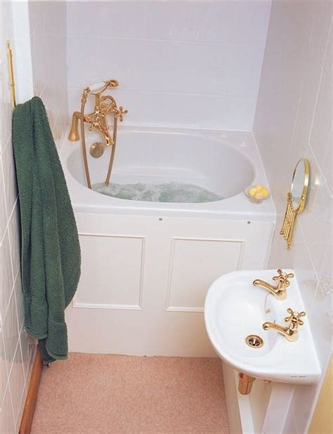 small bathroom idea  corner deep tub  gold tone